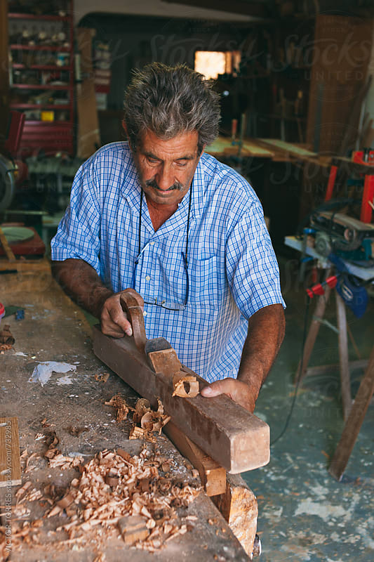 Senior Carpenter Working in His Workshop by Victor Torres for Stocksy United