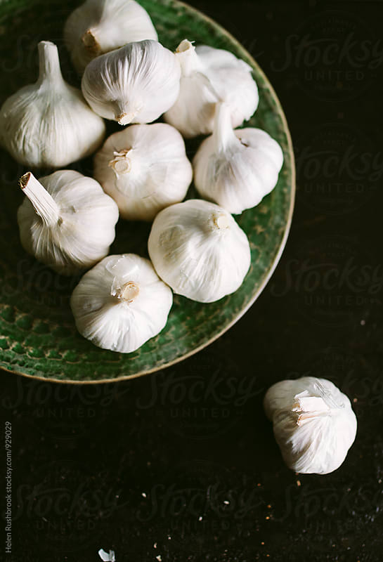 Garlic bulbs by Helen Rushbrook for Stocksy United