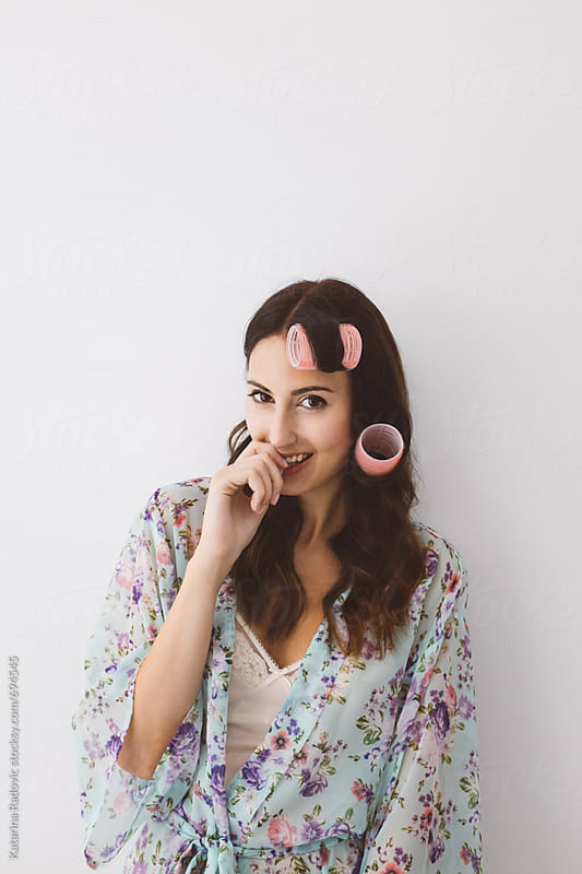 Pretty Woman With Pink Hair Curlers  by Katarina Radovic for Stocksy United