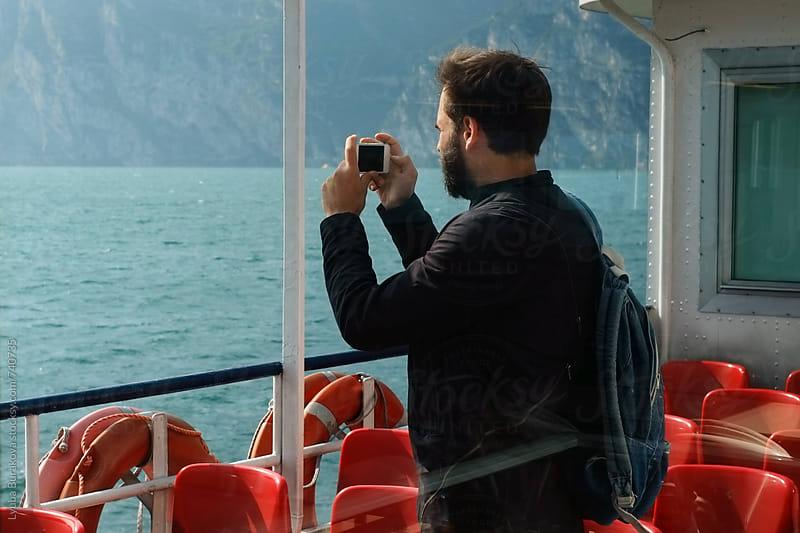Man taking a photo with a smartphone  by Liubov Burakova for Stocksy United