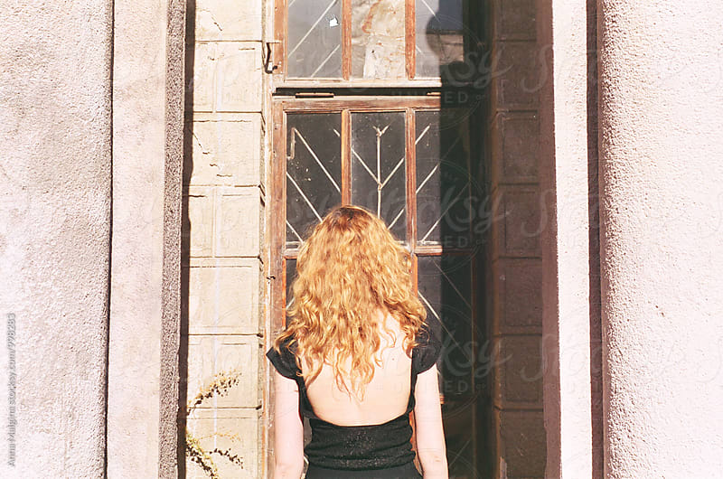 A back-portrait of a young beautiful redhead woman by Anna Malgina for Stocksy United