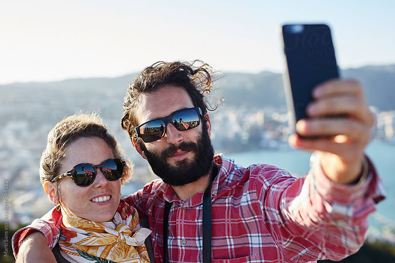 Close-up of couple taking selfie by Martí Sans for Stocksy United