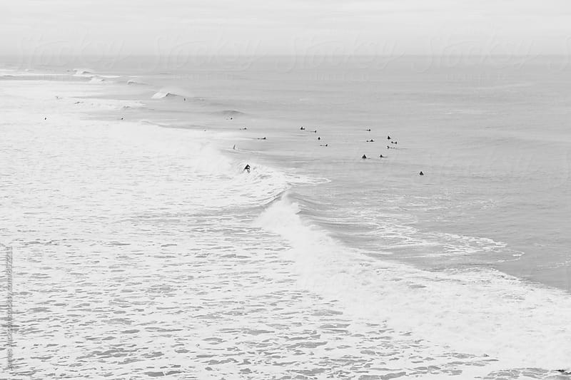 Ocean Beach surfers in black and white. by James Jackson for Stocksy United