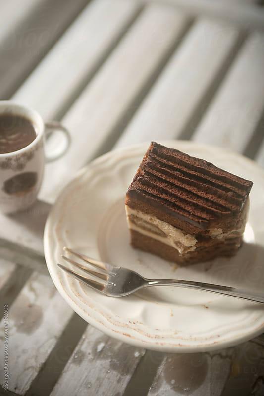 Cut into the Tiramisu cake slice by Csenge Dusha for Stocksy United
