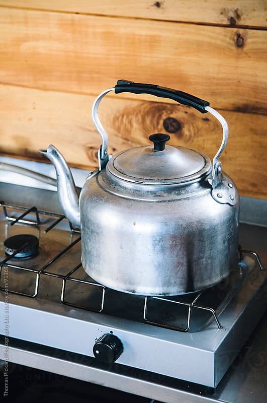 Old fashion kettle on a gas cook top inside a cabin / hut, New Zealand. by Thomas Pickard for Stocksy United