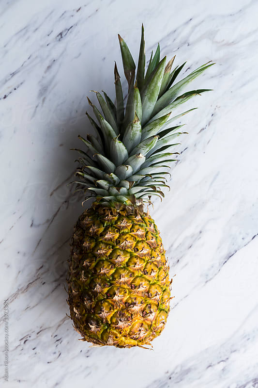 Fresh pineapple by Adam Nixon for Stocksy United