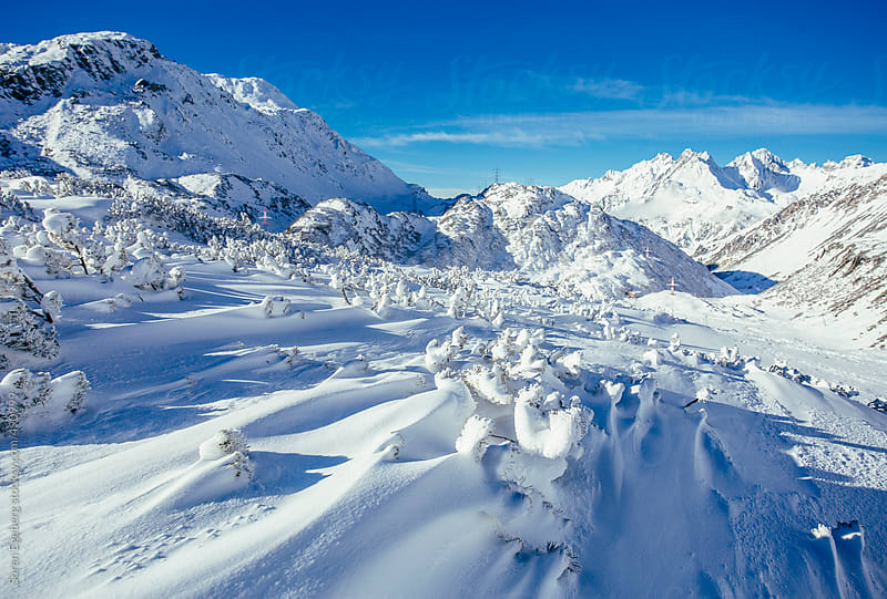 Winter landscape panorama of snow covered mountains in the Austrian Alps. by Soren Egeberg for Stocksy United