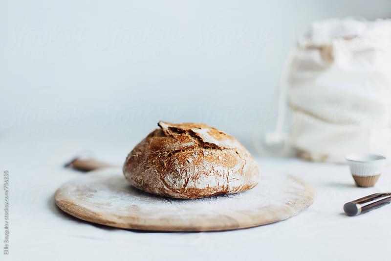 Freshly baked whole grain bread by Ellie Baygulov for Stocksy United