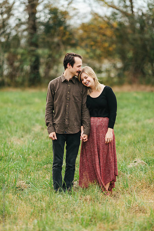 College Aged Couple Facing Camera in Love by B. Harvey for Stocksy United