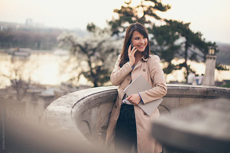 Businesswoman Making a Phone Call by Lumina for Stocksy United