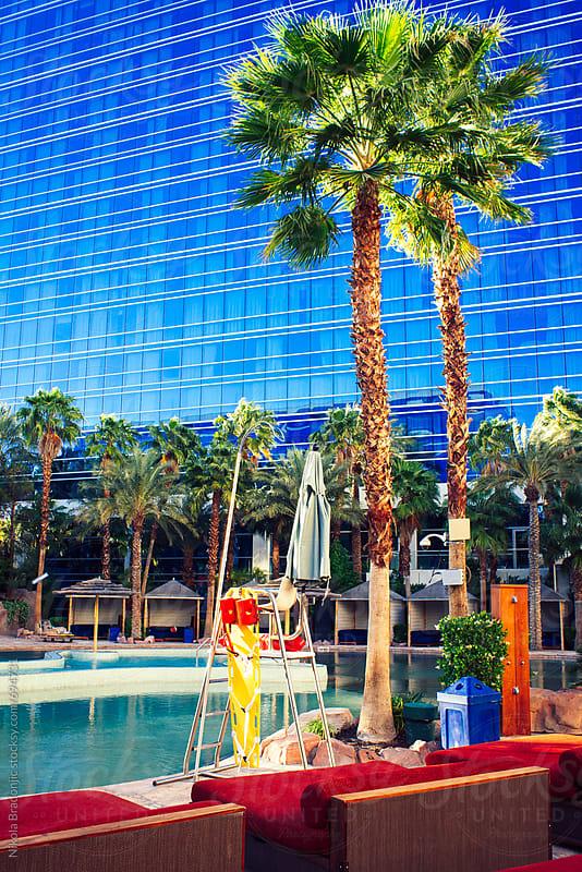 Poolside in Las Vegas hotel by Nikola Bradonjic for Stocksy United