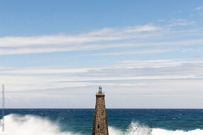 Small Lighthouse and waves by Marilar Irastorza for Stocksy United