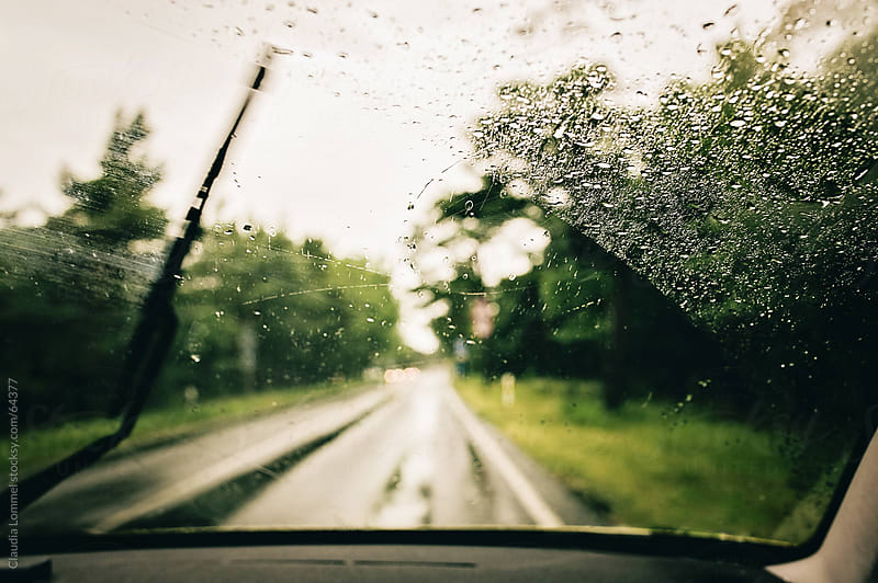 rain drops on the windshield by Claudia Lommel for Stocksy United