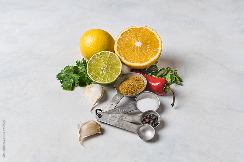Ingredients to Cook Cuban Mojo by suzanne clements for Stocksy United