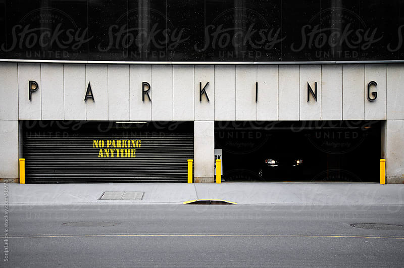 car exiting from the parking garage in new york city by Sonja Lekovic for Stocksy United