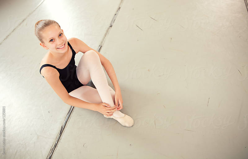 Ballet: Cute Dancer Putting on Ballet Slippers by Sean Locke for Stocksy United