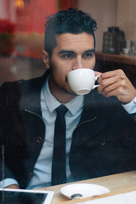 Businessman during a coffee break by Good Vibrations Images for Stocksy United