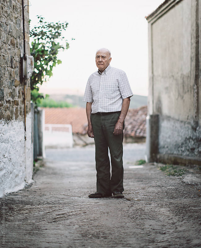 Portrait of a senior man by Nasos Zovoilis for Stocksy United