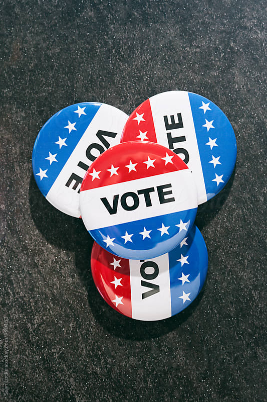 Vote: Pile Of Vote Buttons On Dark Background by Sean Locke for Stocksy United