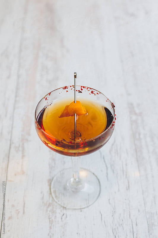 classic manhattan cocktail with orange peel from above on white background by Leander Nardin for Stocksy United