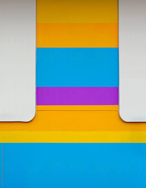 Blue Purple Yellow Orange at horizontal strip of wall background by Wenhai Tang for Stocksy United