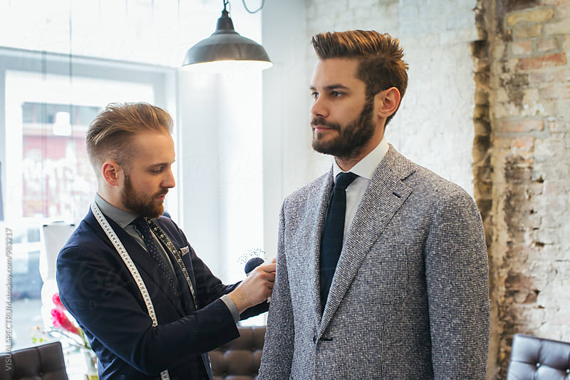 Men's Fashion - Young Caucasian Tailor Adjusting Suit of Young Caucasian Customer by Julien L. Balmer for Stocksy United