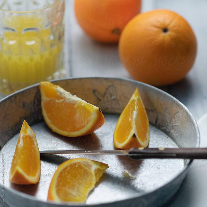 Freshly squeezed orange juice by Branislav Jovanović for Stocksy United