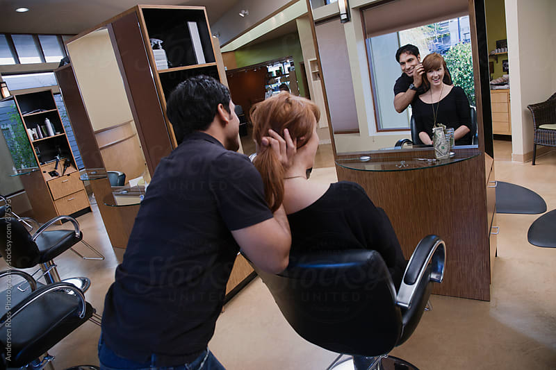 Hairdresser taking care of customer in hair salon by Andersen Ross Photography for Stocksy United