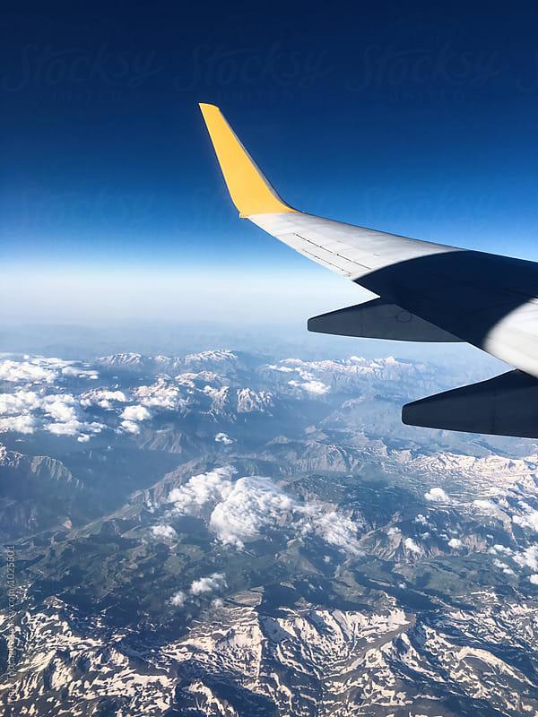 Aeroplane shot above mountains by Maja Topcagic for Stocksy United