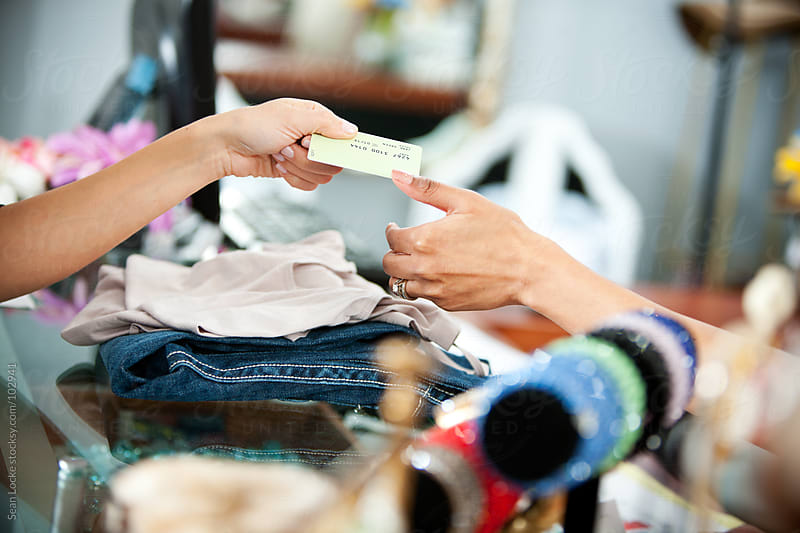 Boutique: Handing Credit Card to Saleswoman by Sean Locke for Stocksy United
