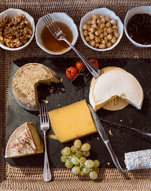 assortment of cheese and nuts from above by Sonja Lekovic for Stocksy United