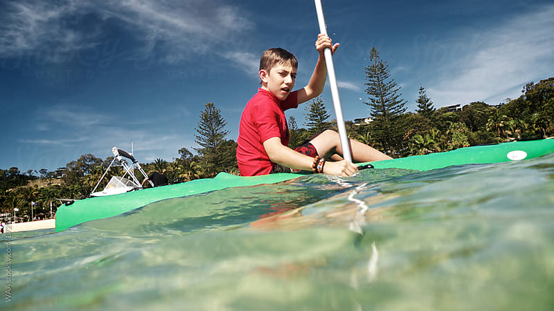 Young Boy Sea Kayaking by WAA for Stocksy United