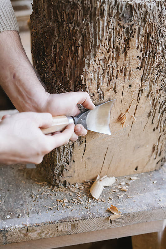 Woodworker using chisel by Alberto Bogo for Stocksy United