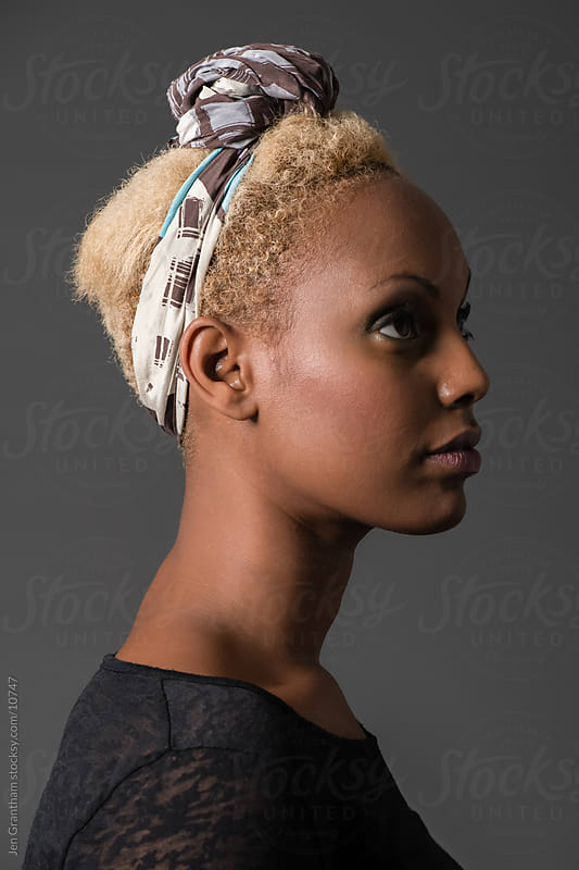 Black woman with blonde hair by Jen Grantham for Stocksy United