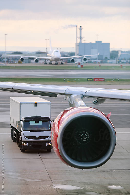 Airplane jet engine at airport terminal by Matthew Spaulding for Stocksy United