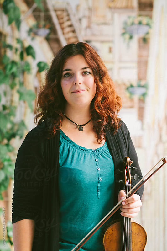 Young woman holding a violin  by kkgas for Stocksy United