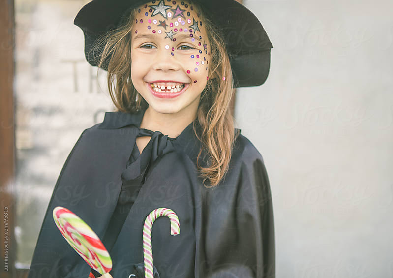Smiling Halloween Witch by Lumina for Stocksy United