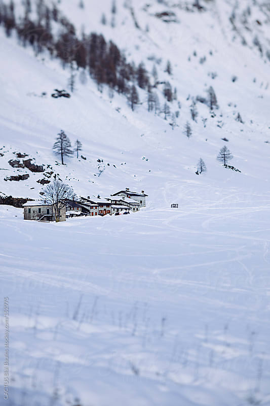 Snow covered Alps Landscape. Small village on the mountains. by CACTUS Blai Baules for Stocksy United