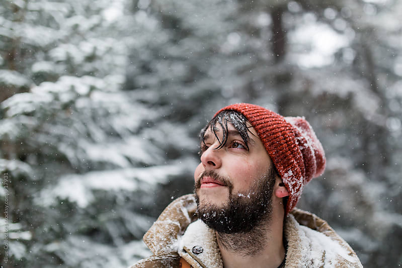 Portrait of a man outdoors. Snowing by Blue Collectors for Stocksy United