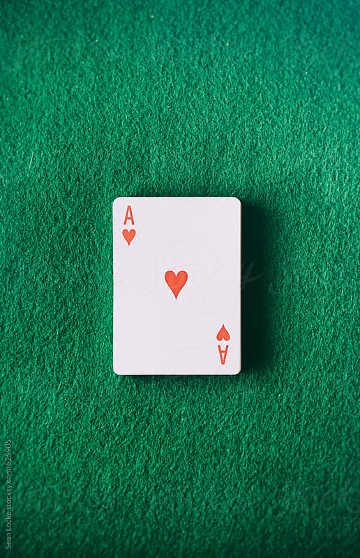 Cards: Ace Of Hearts Sits On Green Felt Table by Sean Locke for Stocksy United