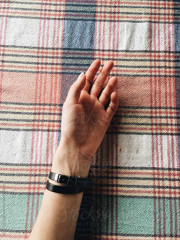 Female hand on a retro tablecloth by Maja Topcagic for Stocksy United