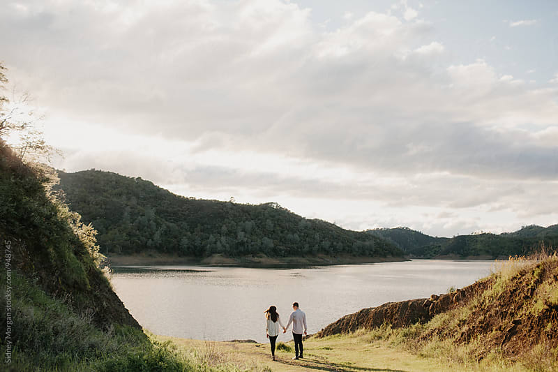 Portrait of Couple in front of Lake by Sidney Morgan for Stocksy United