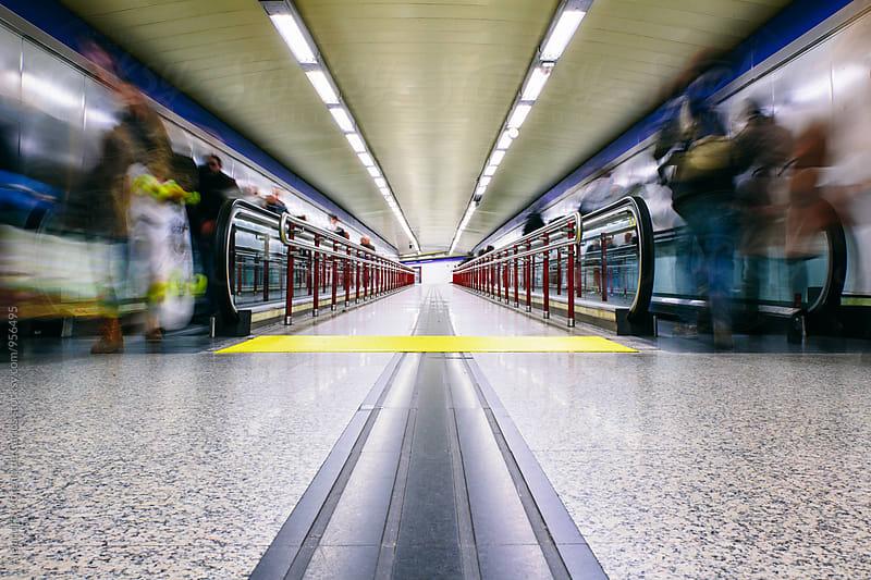 People walking in subway by Alejandro Moreno de Carlos for Stocksy United
