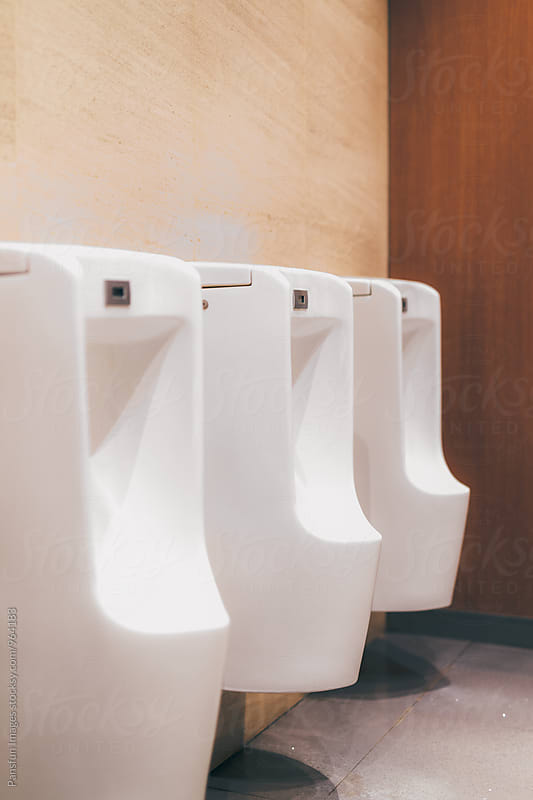 public urinals by Xunbin Pan for Stocksy United