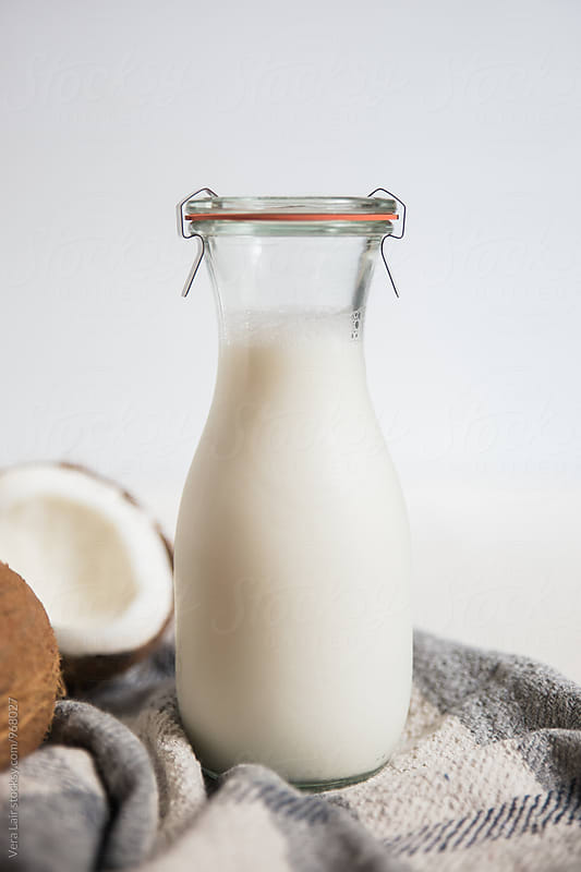 Small bottle of coconut milk by Vera Lair for Stocksy United