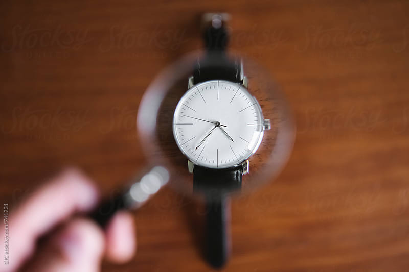 Magnifying lens on a vintage watch by GIC for Stocksy United