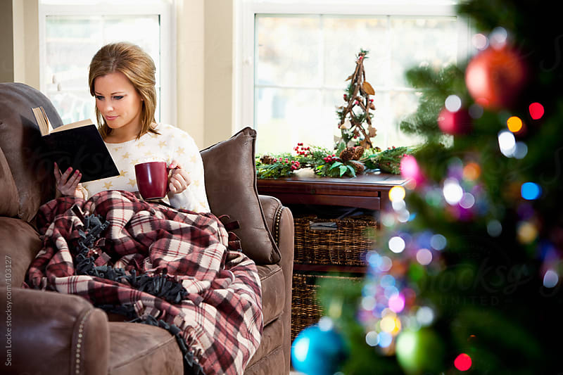 Christmas: Enjoying Holiday With Book and Cocoa by Sean Locke for Stocksy United