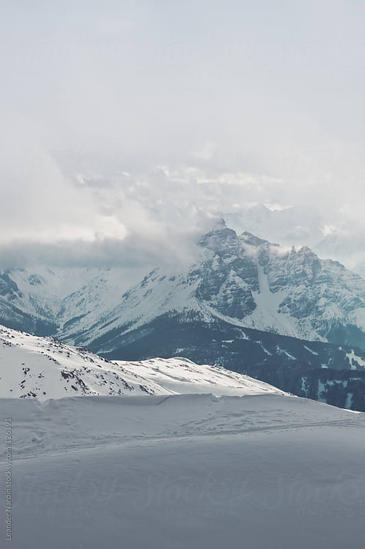 snowcovered mountains in the austrian alps by Leander Nardin for Stocksy United