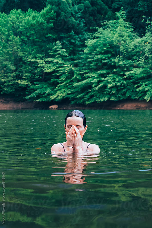 woman swimming in a outdoor forest lake by Micky Wiswedel for Stocksy United