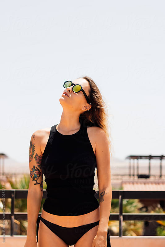 Attractive woman on the terrace under the sun by Susana Ramírez for Stocksy United